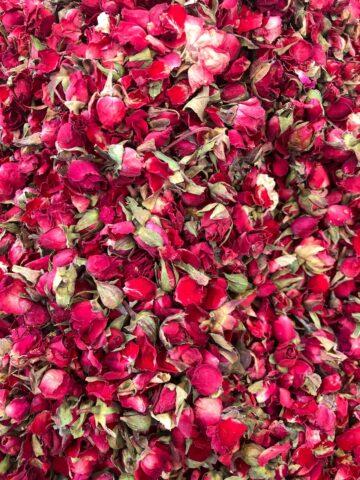 vibrant dark edible rose buds fill the frame