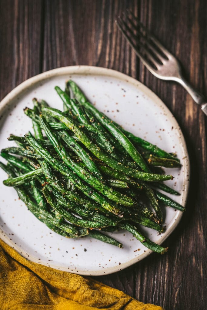 frozen green beans in air fryer side dish on white plate