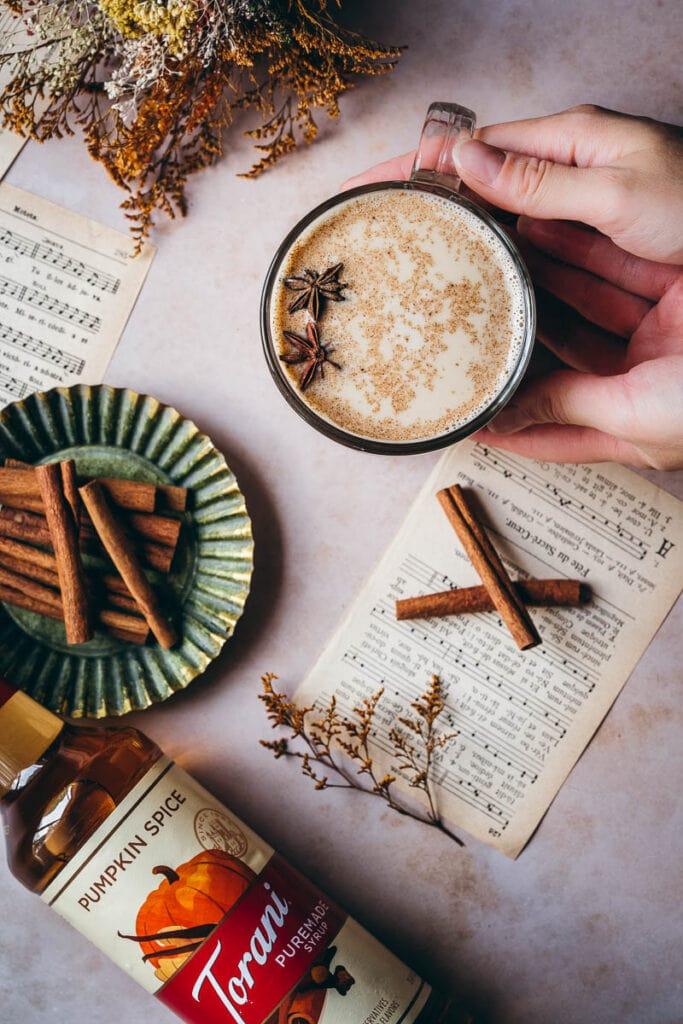 hands holding a cozy warm autumn beverage