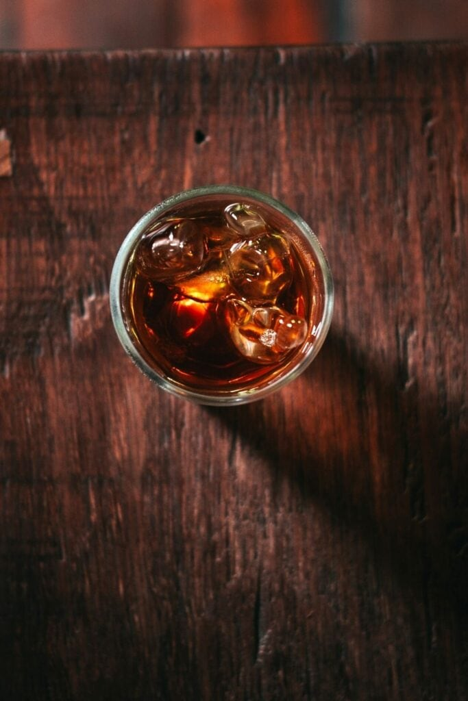 a top shot view of rum in a clear glass