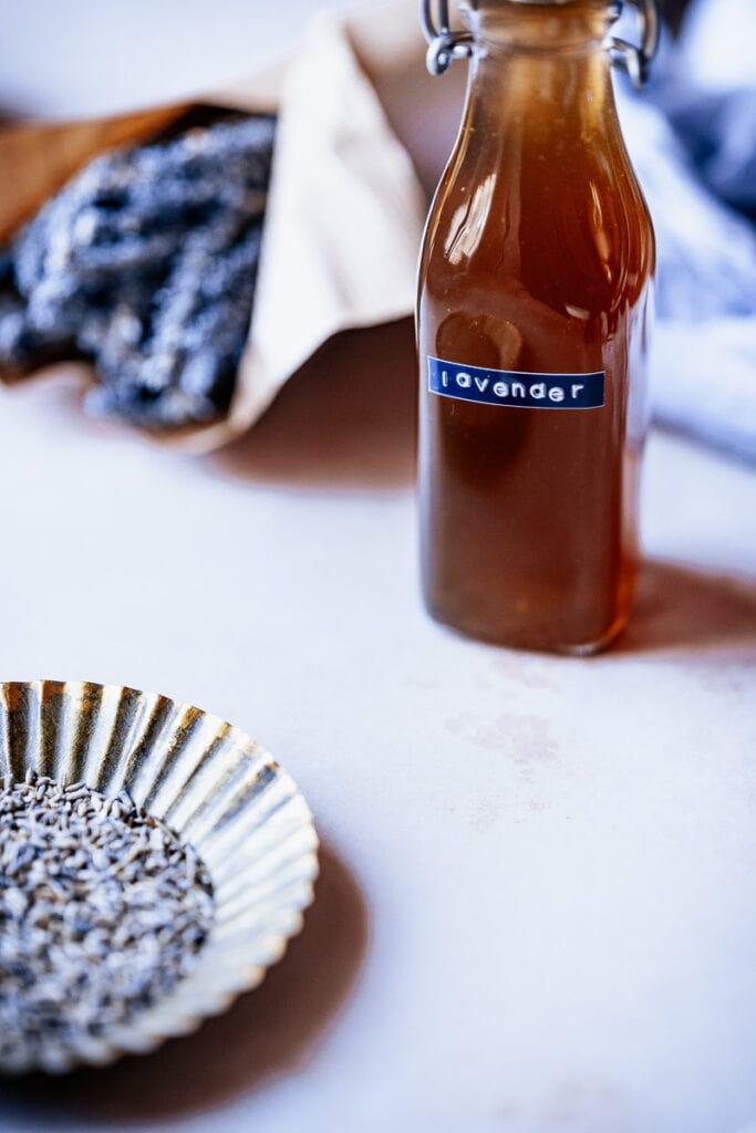 lavender simple syrup recipe in a clear bottle